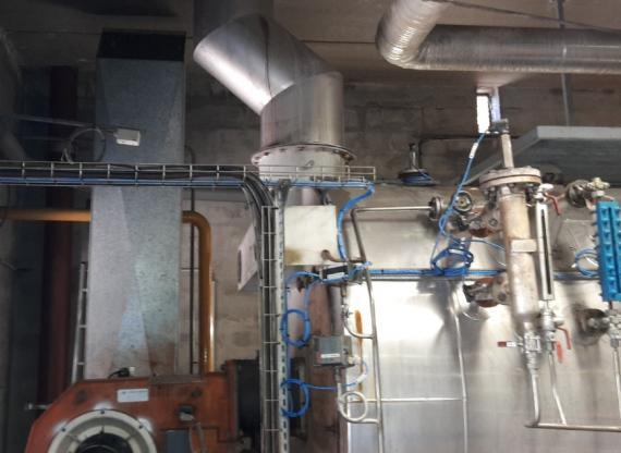 Gaine de prélèvement d'air comburant chaud en partie haute du local chaufferie - Source CETIAT